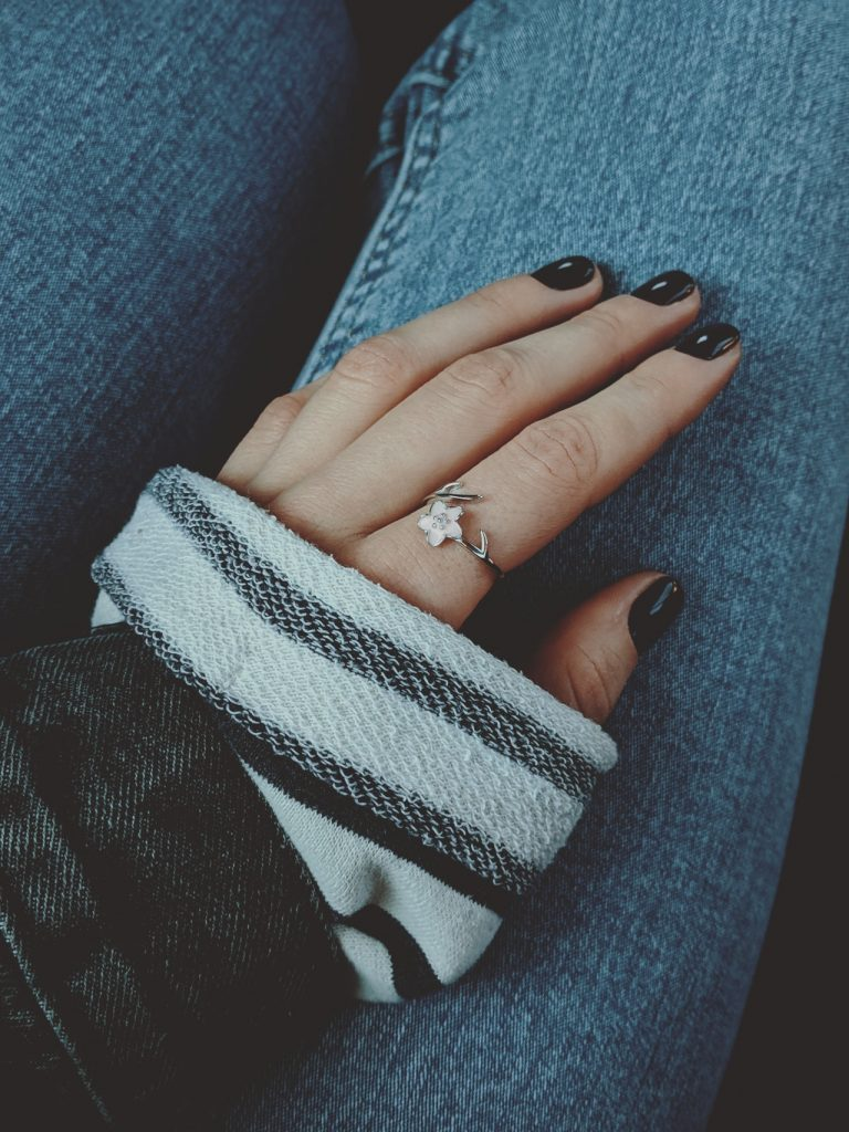 woman wearing a dainty ring.