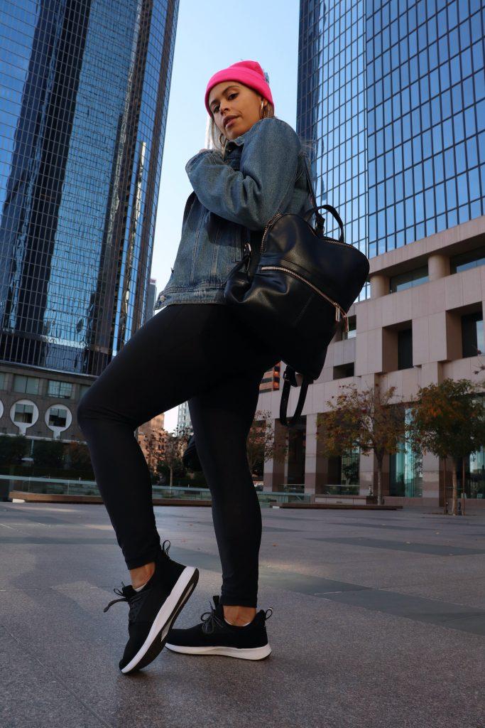 Broke & Chic blogger wearing waterproof sneakers by Loom Footwear.