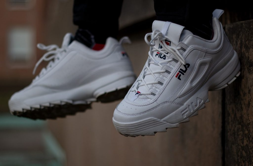 Man wearing FILA sneakers.