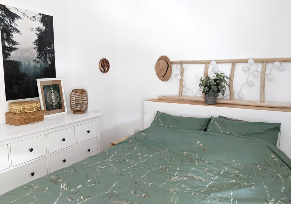 Boho inspired bedroom with IKEA dresser.