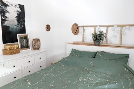 Boho inspired bedroom with IKEA dresser.