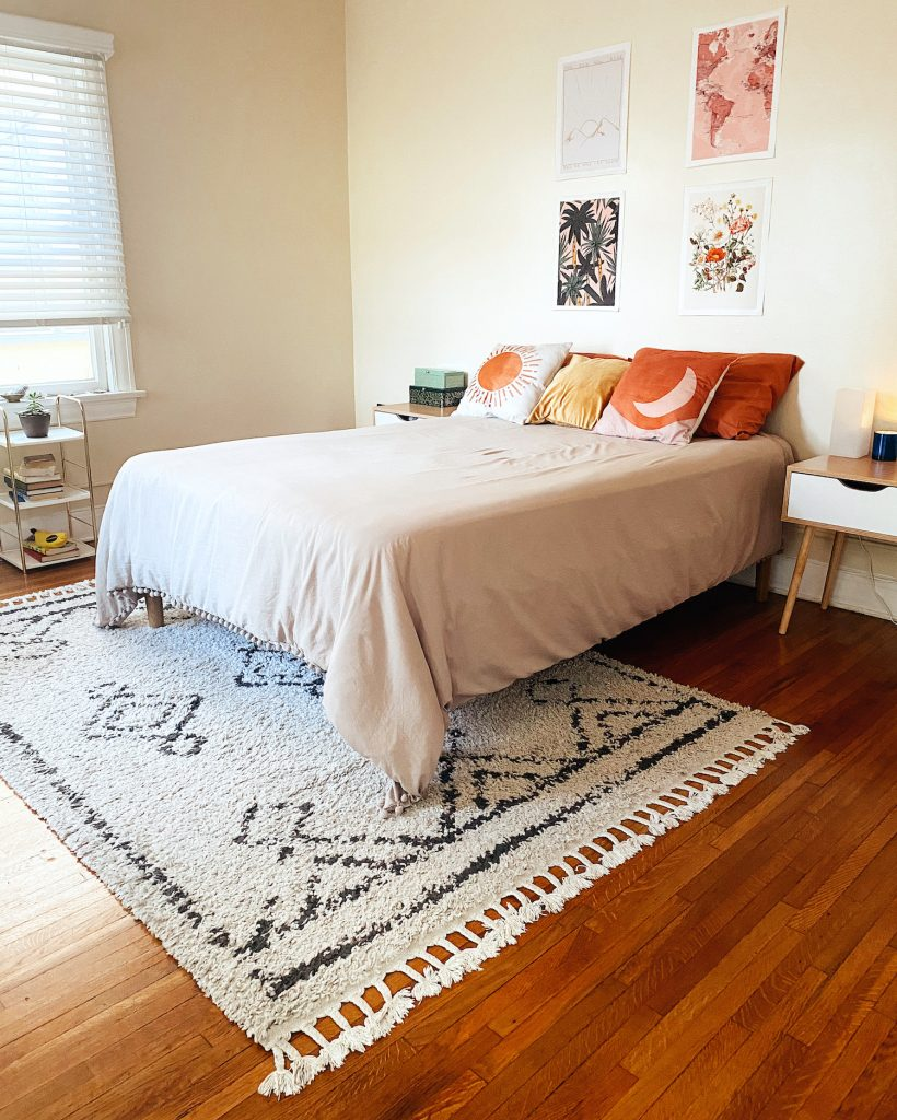 Boho chic area rug in a large bedroom.