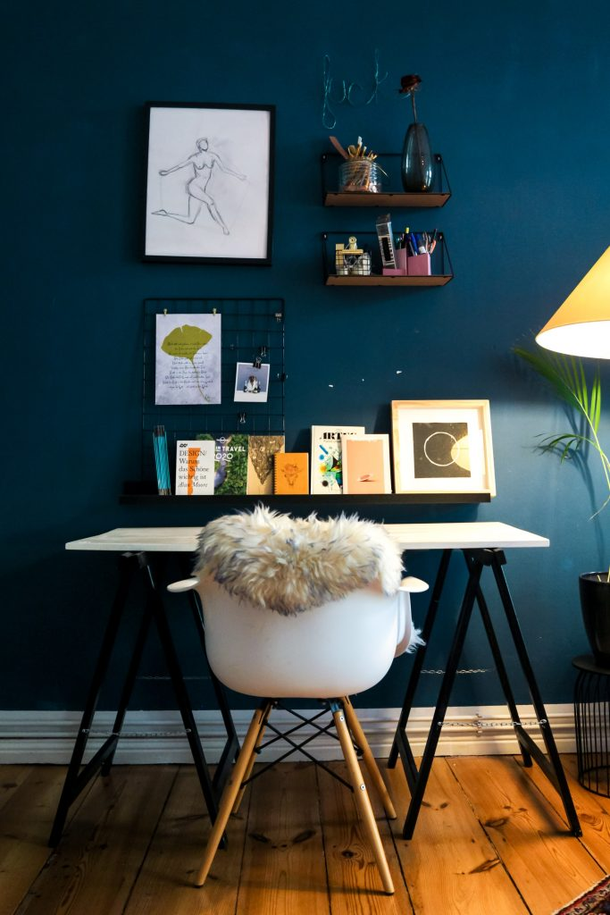 Teal statement wall in home office.