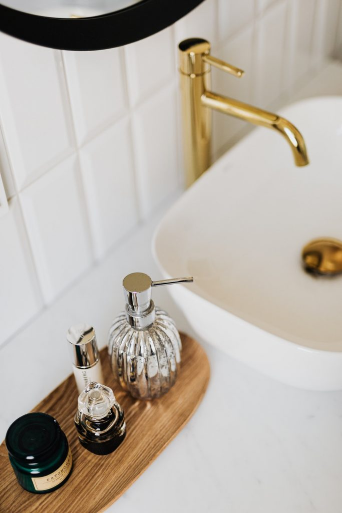 Gold faucet in bathroom