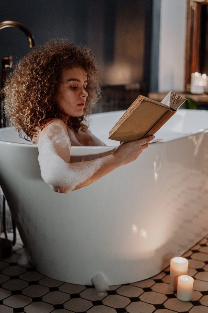 Woman reading in a bathtub.