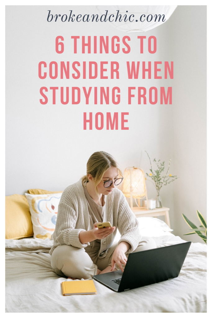 Woman with blonde hair studying on her bed.