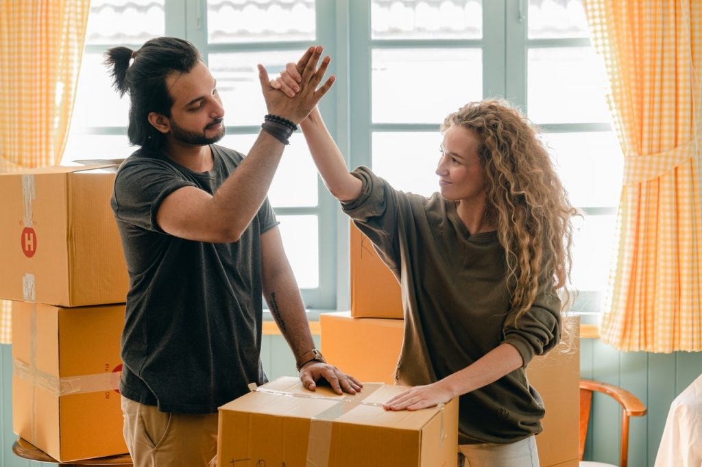Couple high-fiving each other during a move.