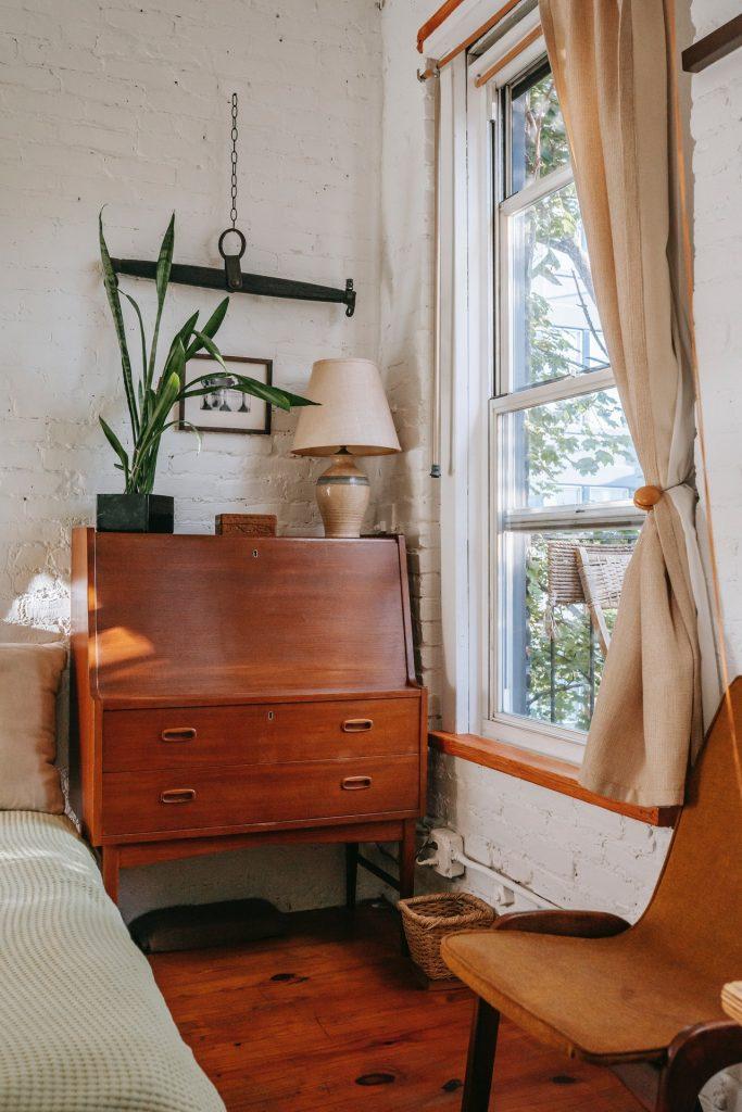 Antique cabinet next to a loft window.