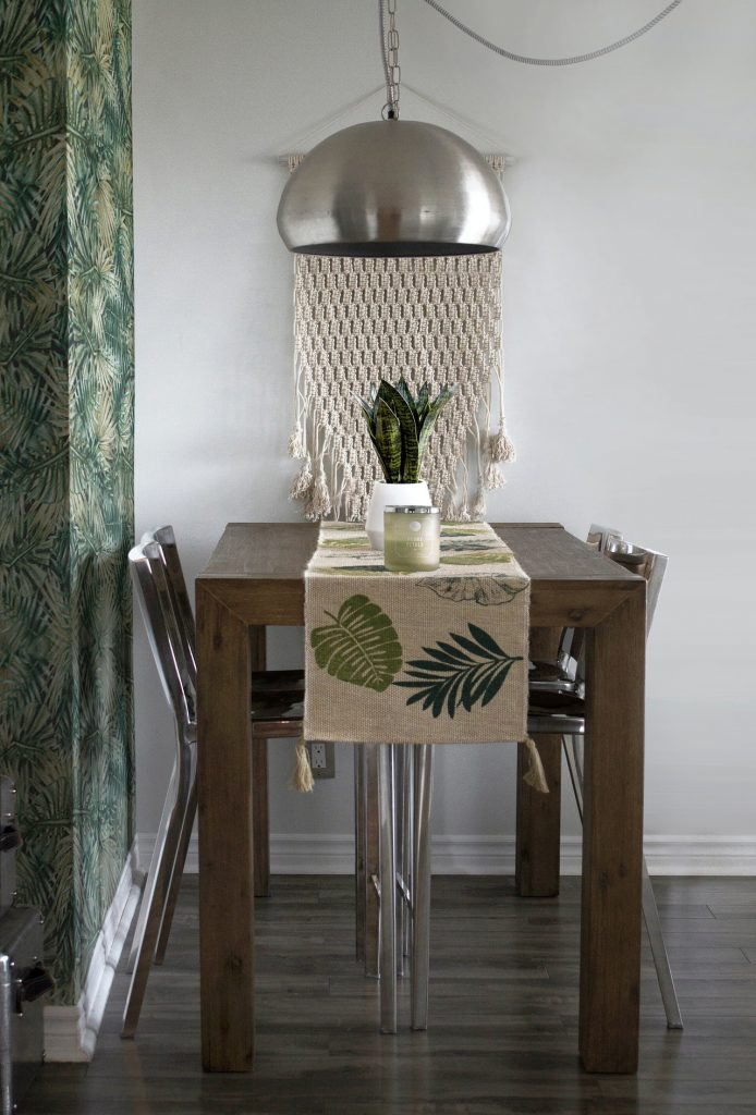 nature inspired decor with jungle leaf wallpaper.