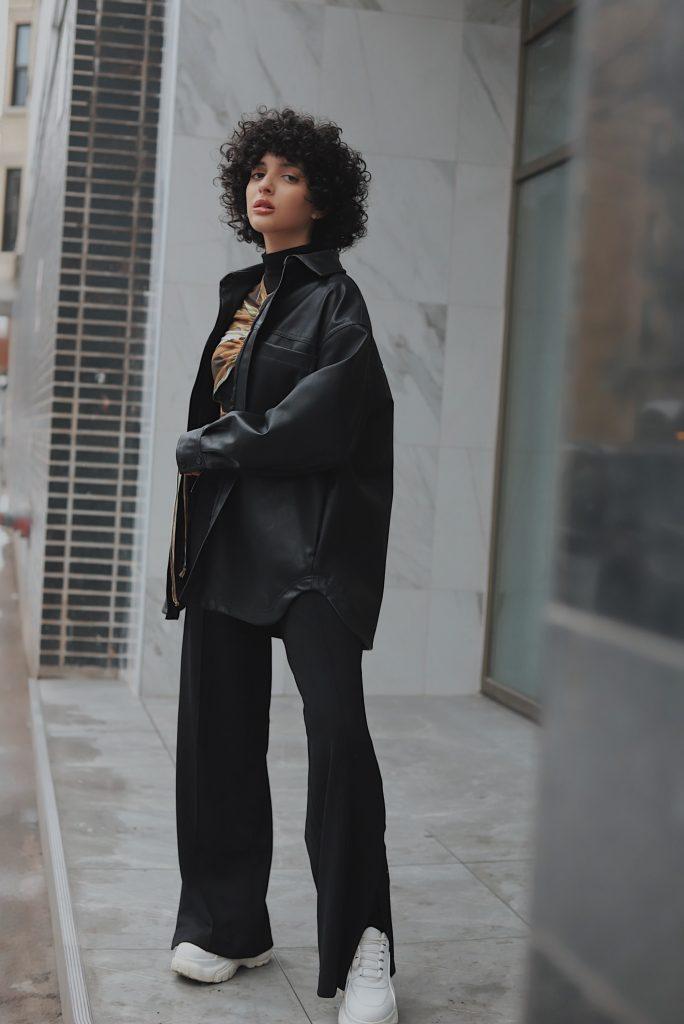 Stylish woman wearing split leg trousers.
