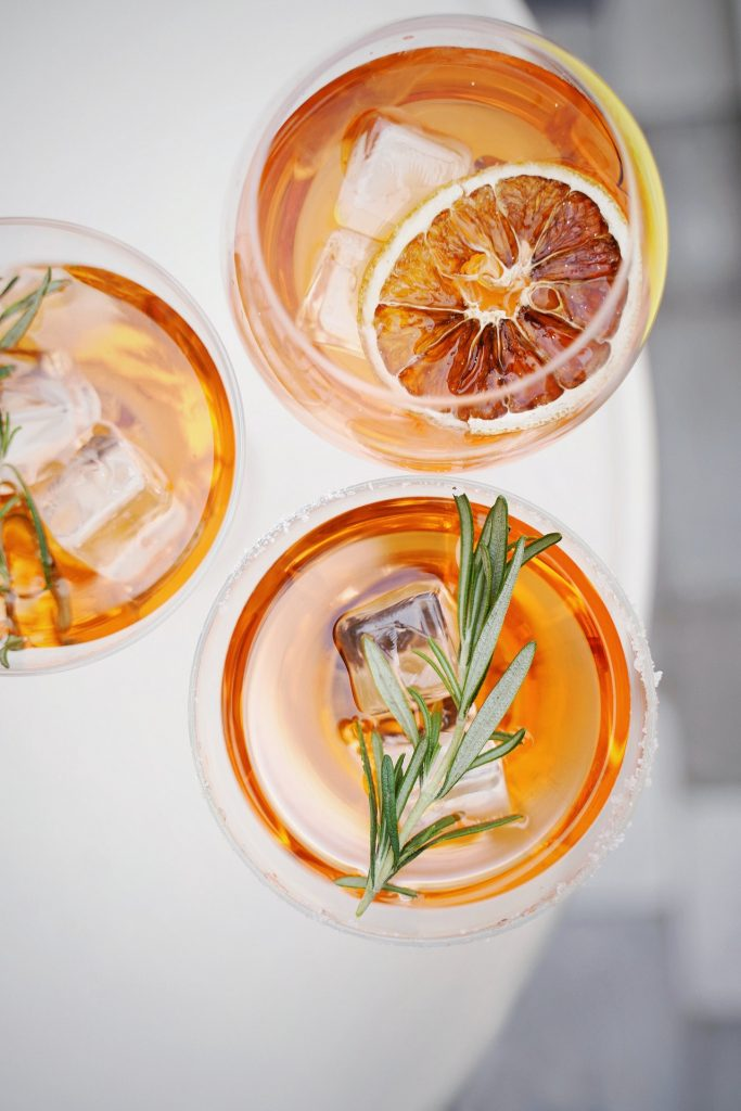 Summer cocktail with oranges and rosemary.