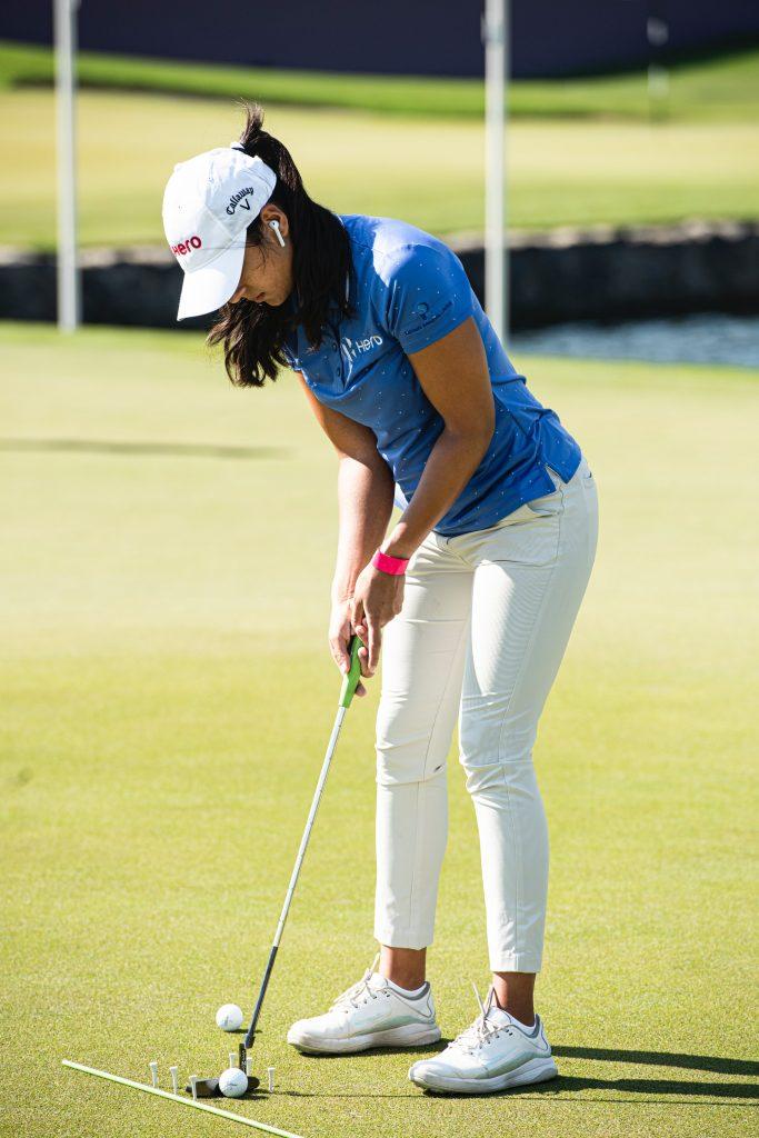Woman playing golf.