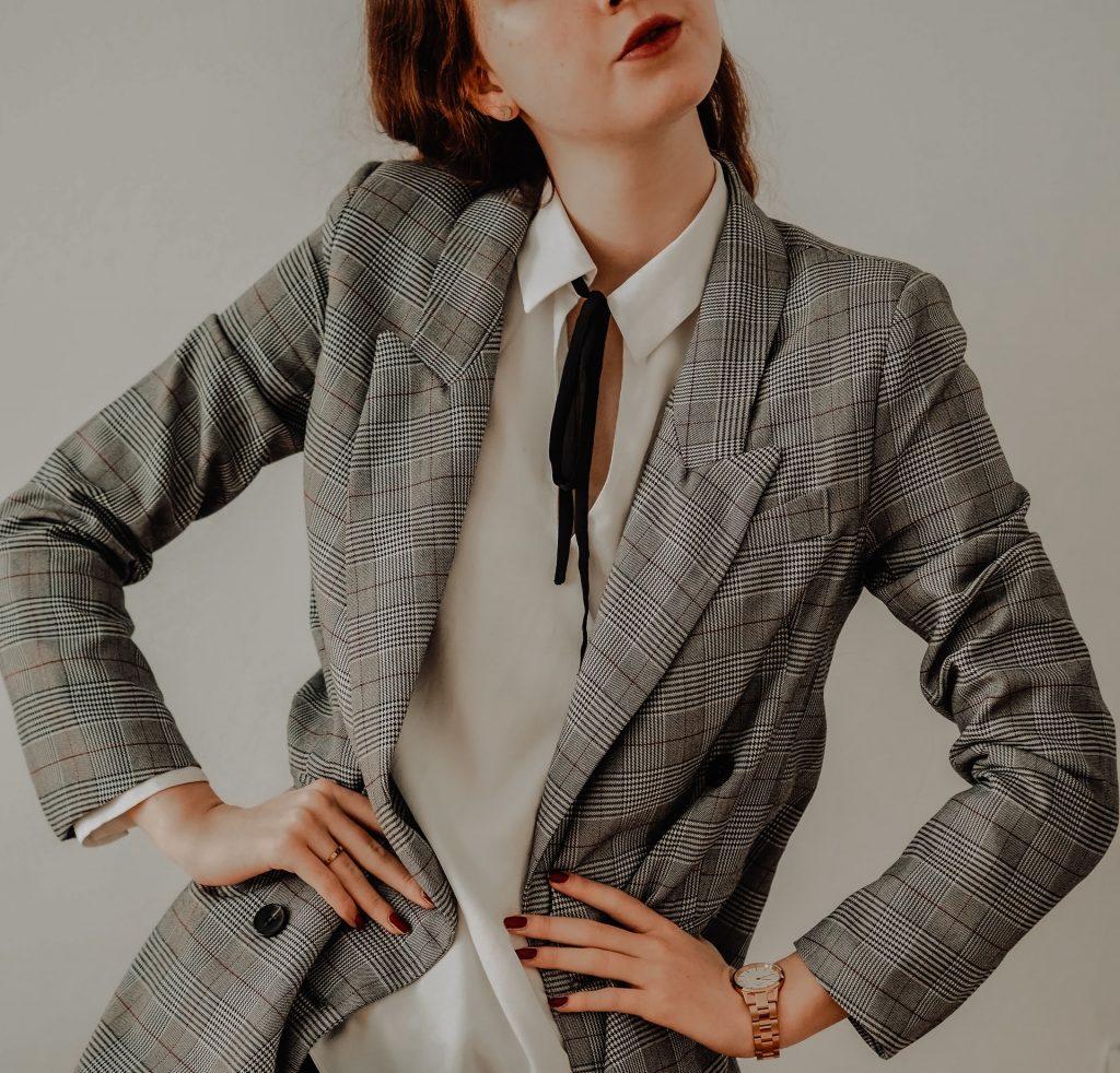 Woman wearing a plaid blazer.