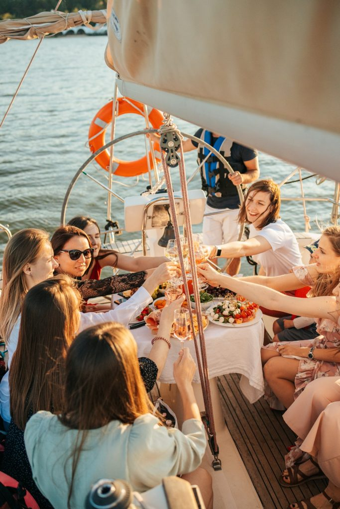 Friends doing a toast on a boat.