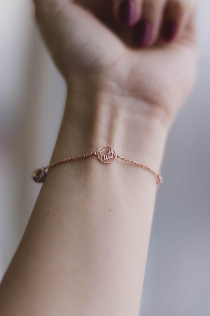 Woman wearing a faith bracelet
