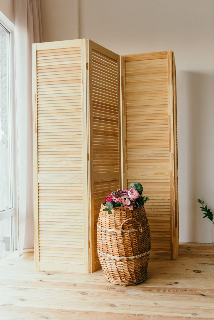 room divider with flowers in front of it.