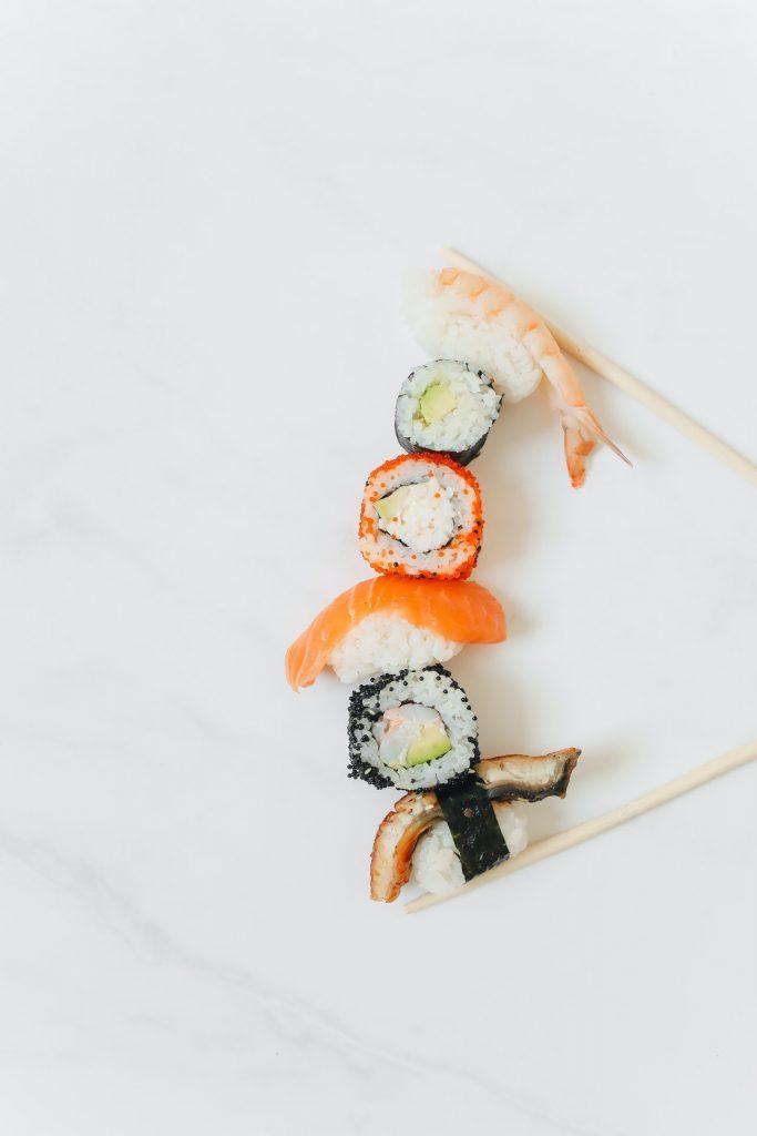 Sushi and sashimi on a white background.