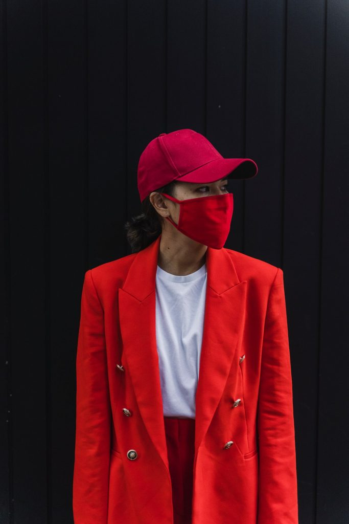 Woman wearing a red face mask to protect herself from COVID-19.