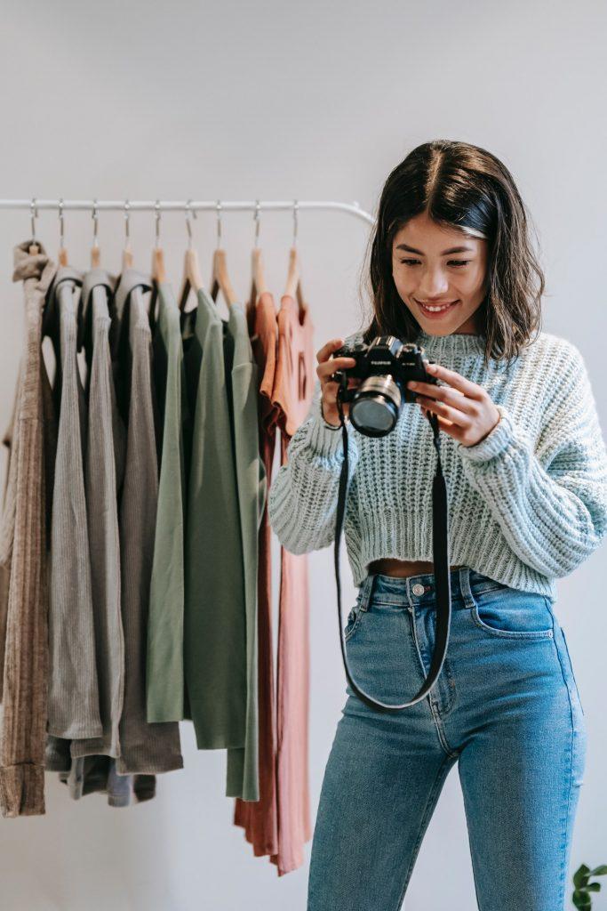 Blogger looking through DSLR camera
